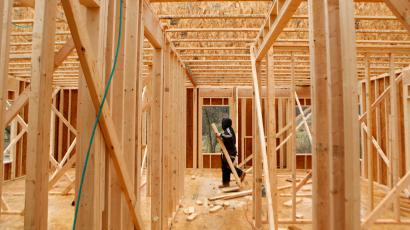 A worker carries a plank at the construction site of a new house in Alexandria, Virginia February 16, 2012. The U.S. Commerce Department said housing starts rose 1.5 percent to an annual rate of 699,000 units last month, beating economists' expectations for a 675,000-unit pace. Starts were boosted by multi-unit buildings, reflecting growing demand for rental apartments as Americans move away from homeownership. Permits for future home construction rose 0.7 percent to a 676,000-unit pace in January.