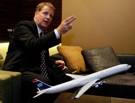 US Airways chief executive Doug Parker speaks during a news conference at Ben Gurion International airport near Tel Aviv July 8, 2009. US Airways has no plans to reduce its capacity any further even as the recession has dampened demand, particularly for business travel, Parker said on Wednesday.
