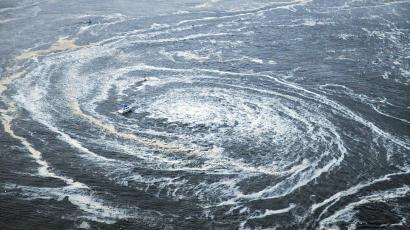 A whirlpool is seen near Oarai City, Ibaraki Prefecture, northeastern Japan, March 11, 2011. The biggest earthquake to hit Japan on record struck the northeast coast on Friday, triggering a 10-metre tsunami that swept away everything in its path, including houses, ships, cars and farm buildings on fire. REUTERS/Kyodo