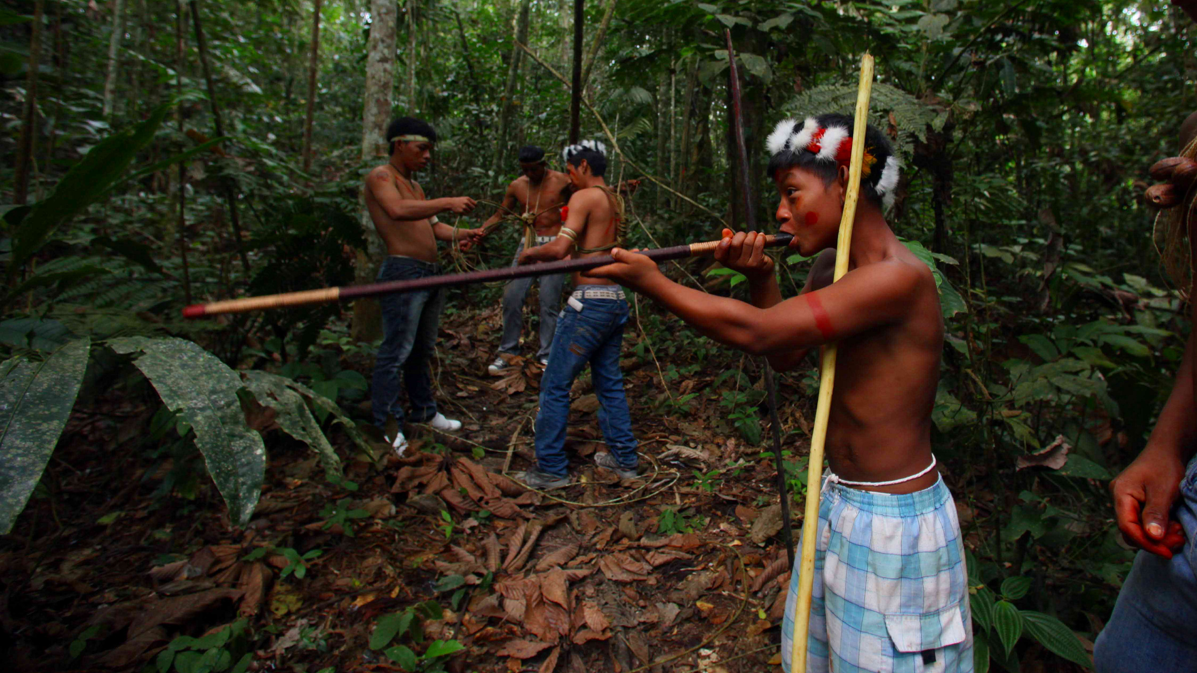 A Waorani indigenous youth practices using a blowpipe in Yasuni National Park in the Upper Napo Valley of the Western Amazon region in Ecuador, Saturday Aug. 21, 2010. Yasuni National Park, a UNESCO Biosphere Reserve since 1989 and home to the Tagaeri-Taromenane and Waorani indigenous communities, holds close to 1 billion barrels of crude. Since 2007 the government of Ecuador's President Rafael Correa has appealed to the international community to provide the Andean nation with funding in exchange for abandoning oil drilling in the reserve.
