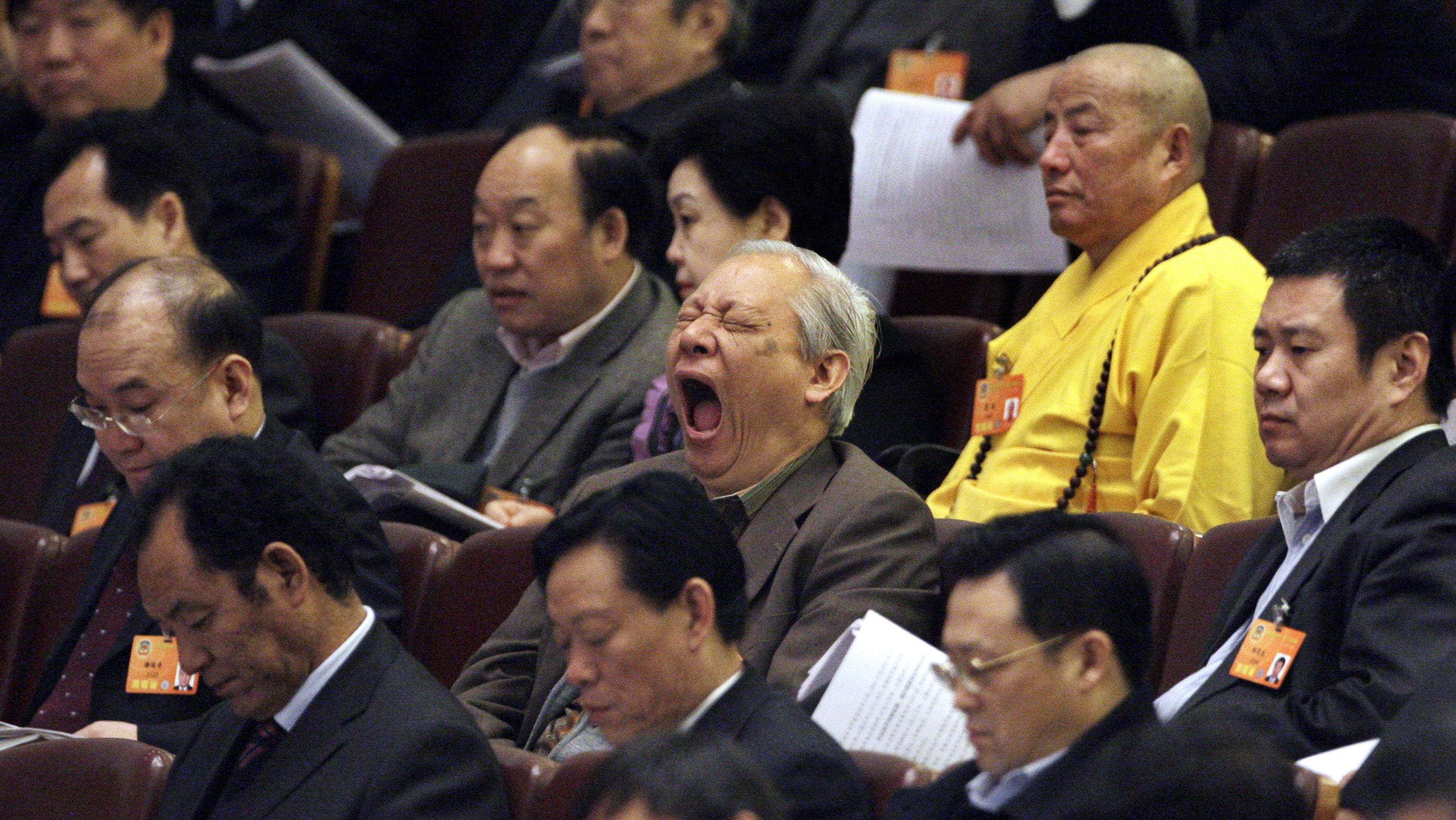 yawning conference goer