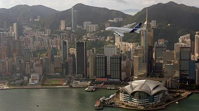 An Airbus A380 flies over Hong Kong's Victoria Harbour during a demonstration flight to mark the Asian Aerospace International Expo and Congress held in the territory September 3, 2007. European plane-maker Airbus expects Chinese airlines will need up to 150 of its jets over the next five years, including its giant A380s, as Chinese airlines expend to serve a domestic and international travel boom. REUTERS/Government Information Services Handout
