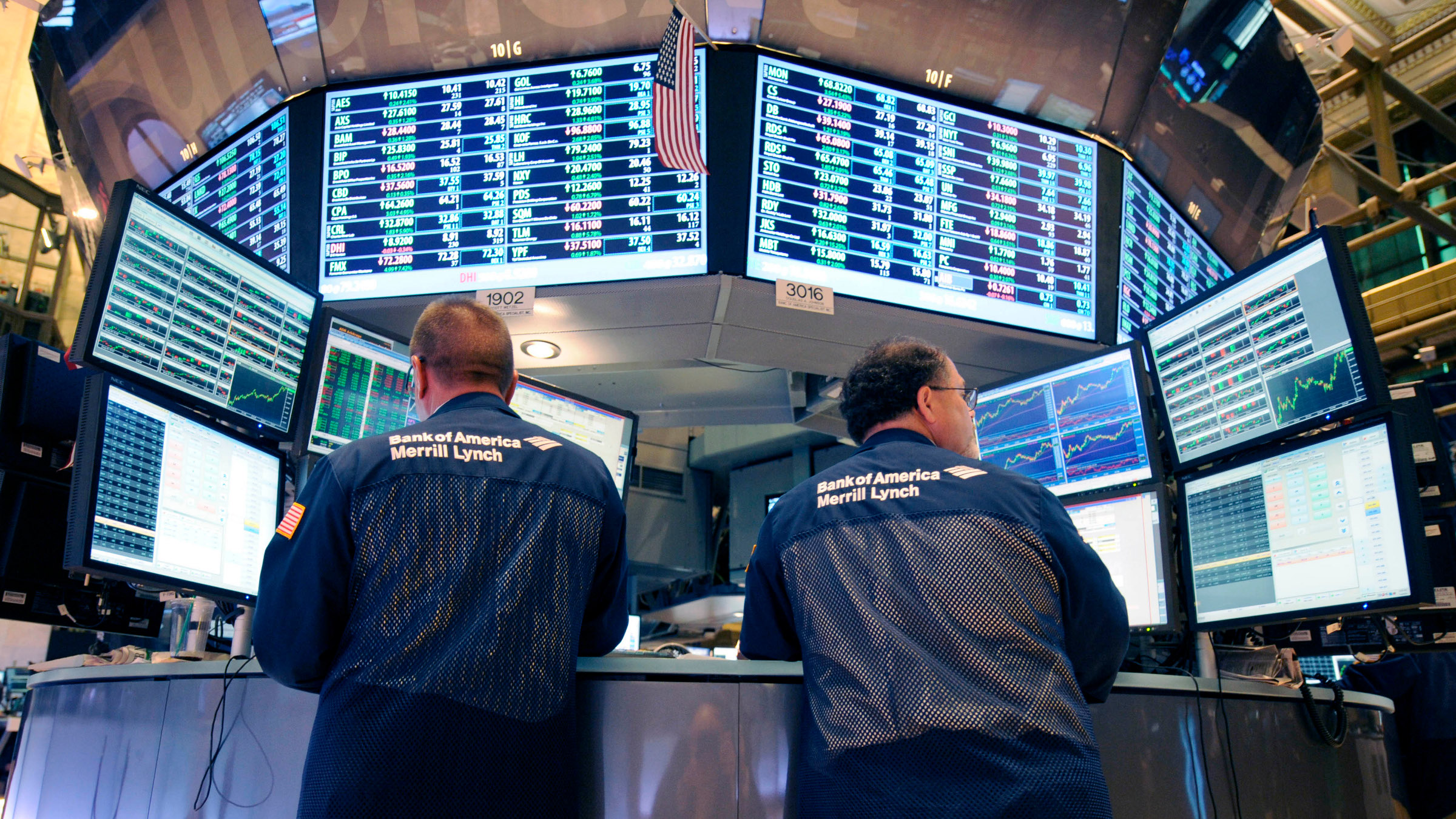 In this Tuesday, Aug. 23, 2011 file photo, Bank of America Merrill Lynch traders work on the floor of the New York Stock Exchange in New York. There are fewer and fewer traders on the NYSE floor because of the dominance of computer trading of securities - including the high-frequency trading that can take advantage of price changes in a millisecond. Bank of America is the stock of the moment for high-frequency trading; investors use computer algorithms to exploit small changes in a stock's price. If a computer can seize on a stock like Bank of America a fraction of a second faster than the rest of the market, it can book a tiny profit.