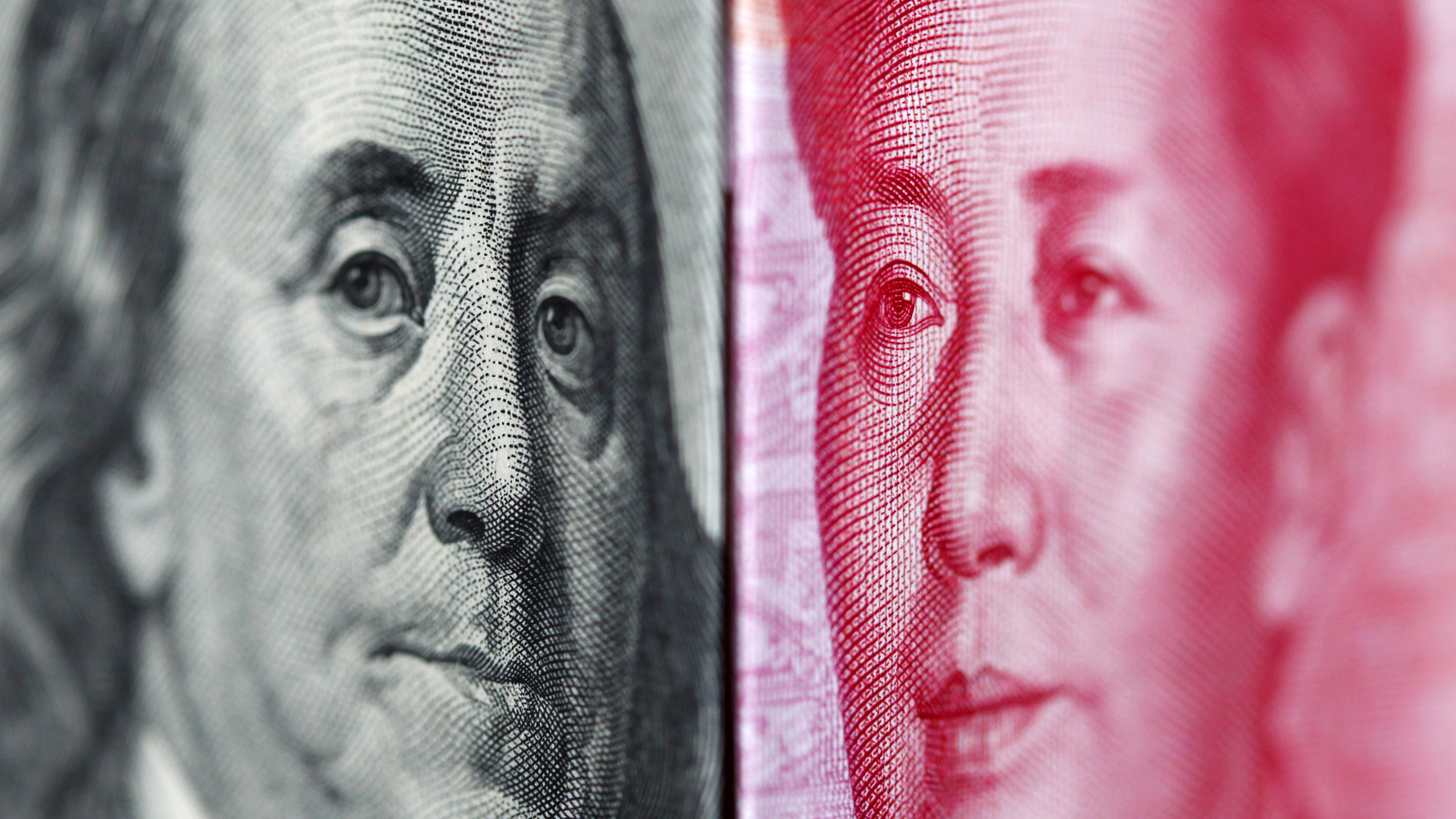 "A 100 yuan banknote is placed beside a U.S. 100 dollar banknote in this illustrative photograph taken in Taipei June 20, 2010. China has ended its ""crisis-mode"" pegging of the yuan to the dollar with a statement that it will gradually increase the flexibility of its exchange rate, an adviser to the central bank Li Daokui told Reuters on Saturday. The notes feature the portraits of Mao Zedong and Benjamin Franklin. REUTERS/Nicky Loh"