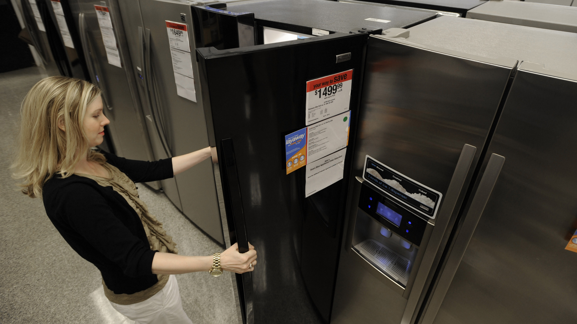 In this photograph taken by AP Images for Sears Holdings Corporation, A consumer checks out a refrigerator at a local Sears' store. The retailer recently extended its layaway program to include home appliances in an effort to help consumers who haven't taken advantage of the government's appliance rebate program. For more information, visit www.Sears.com/layaway. (Paul Beaty/ AP Images for Sears Holdings Corporation