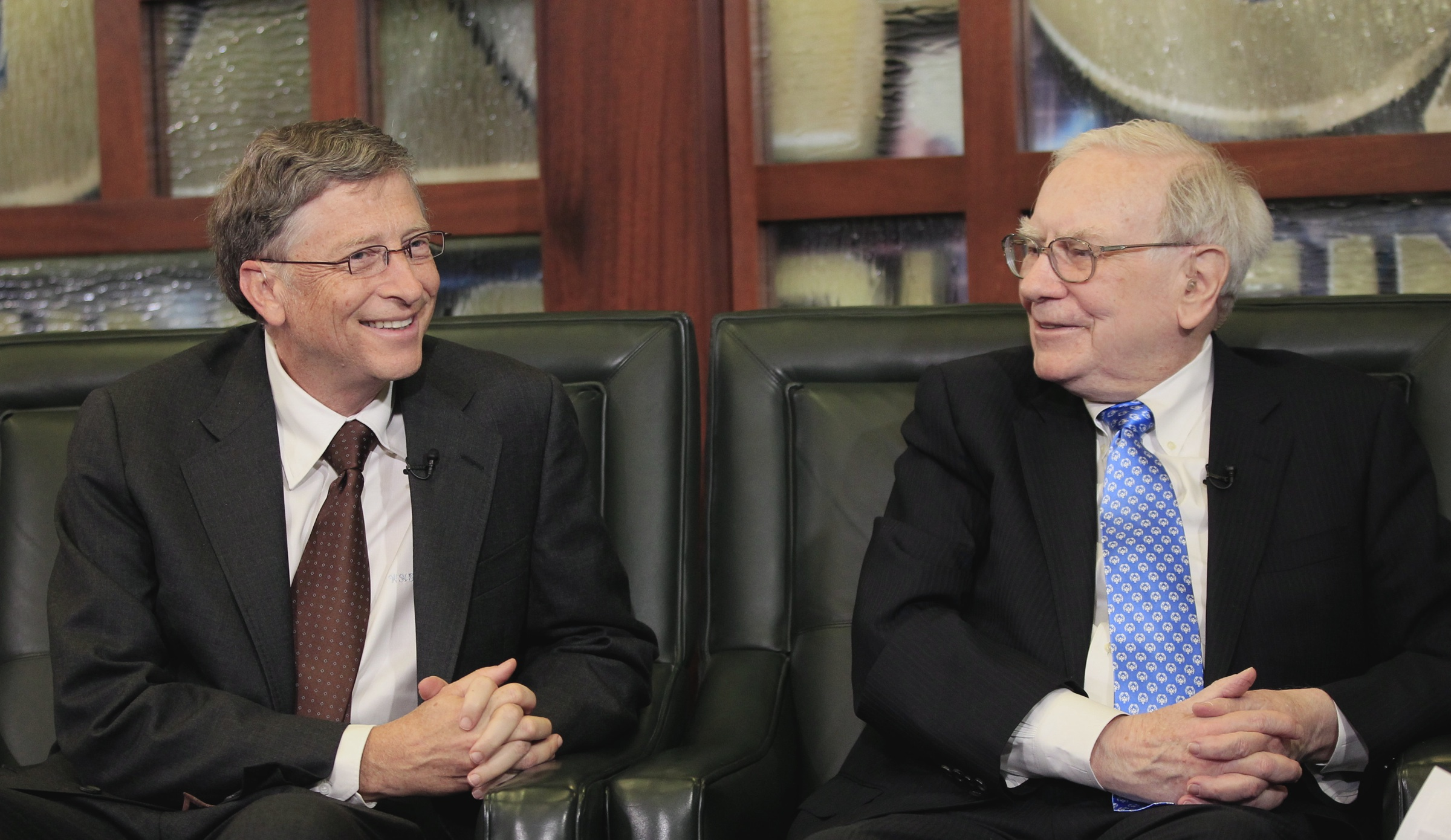Warren Buffett, right, and Bill Gates share a light moment during an interview with Liz Claman of the Fox Business Network, in Omaha, Neb., Monday, May 6, 2013. The Berkshire Hathaway shareholders meeting took place over the weekend. (AP Photo/Nati Harnik)