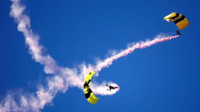 Members of the U.S. Army's Golden Knights parachute team fall to earth above the Homestead-Miami Speedway before running of the Ford 400 NASCAR Nextel Cup race in Homestead, Florida November 19, 2006.