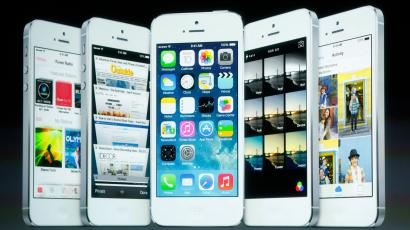Screenshots of the iOS7 are seen on the screen during Apple Inc's media event in Cupertino, California September 10, 2013.