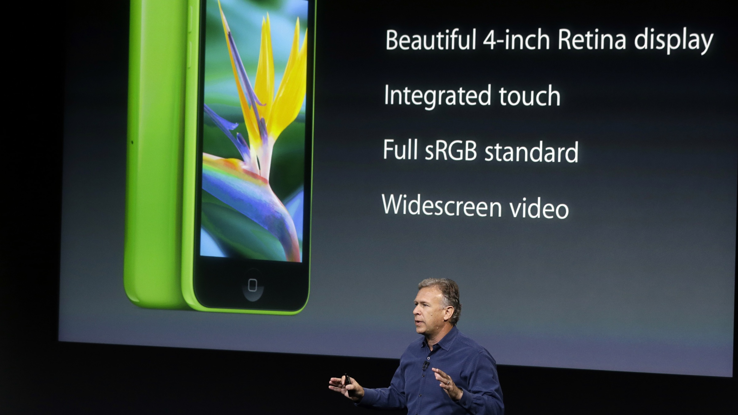 Phil Schiller, Apple's senior vice president of worldwide product marketing, speaks on stage during the introduction of the new iPhone 5c in Cupertino, Calif., Tuesday, Sept. 10, 2013. (AP Photo/Marcio Jose Sanchez)