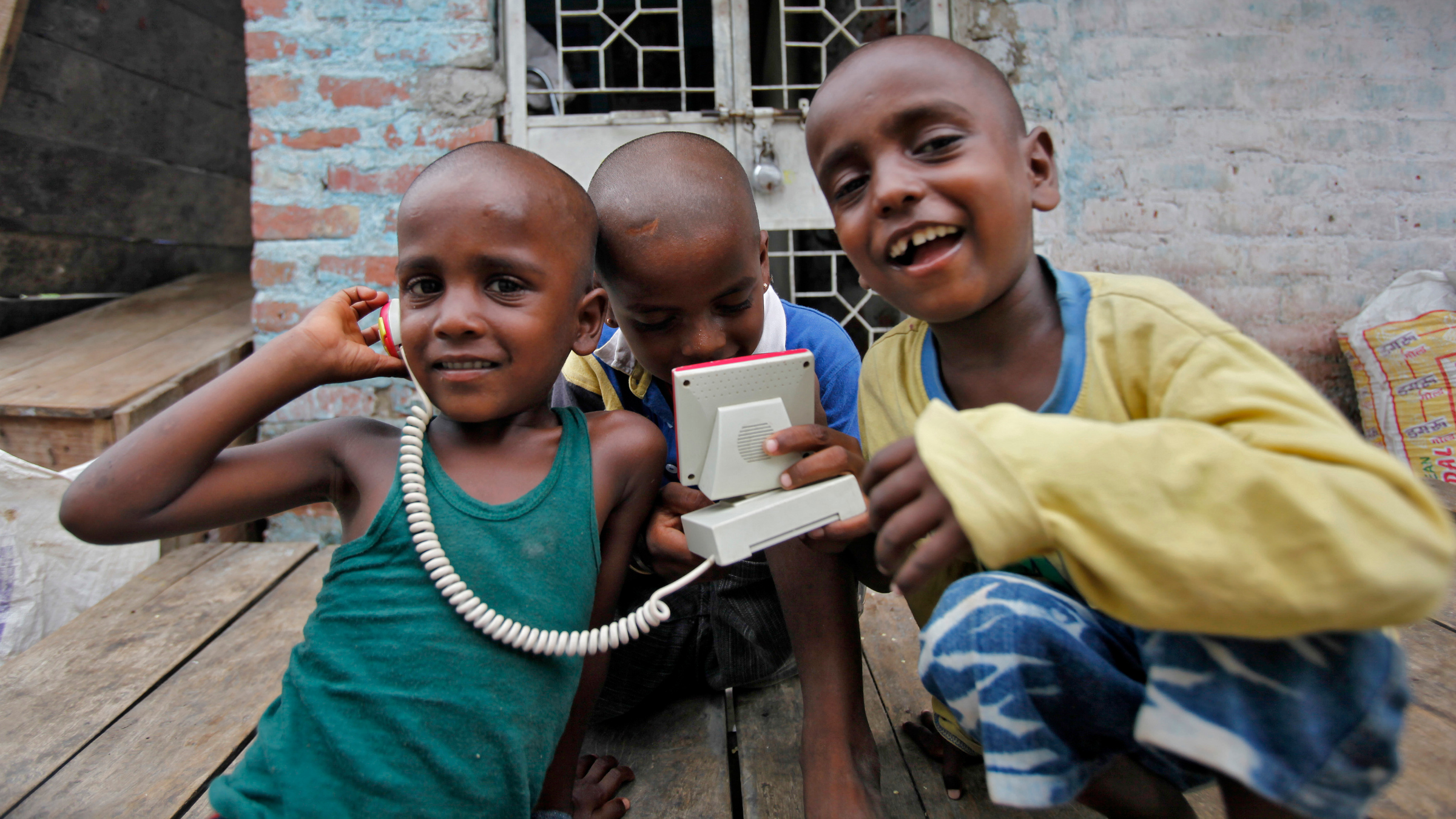 Indian kids playing with toy phones.