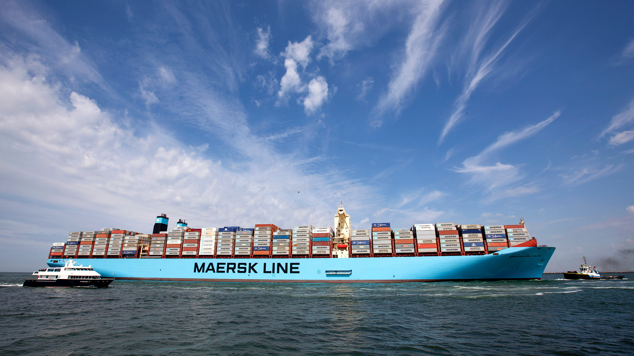 The MV Maersk Mc-Kinney Moller, the world's biggest container ship, arrives at the harbour of Rotterdam August 16, 2013. The 55,000 tonne ship, named after the son of the founder of the oil and shipping group A.P. Moller-Maersk, has a length of 400 meters and cost $185 million. A.P. Moller-Maersk raised its annual profit forecast for the business on Friday, helped by tighter cost controls and lower fuel prices. Maersk shares jumped 6 percent to their highest in 1-1/2 years as investors welcomed a near-doubling of second-quarter earnings at container arm Maersk Line, which generates nearly half of group revenue and is helping counter weakness in the company's oil business.