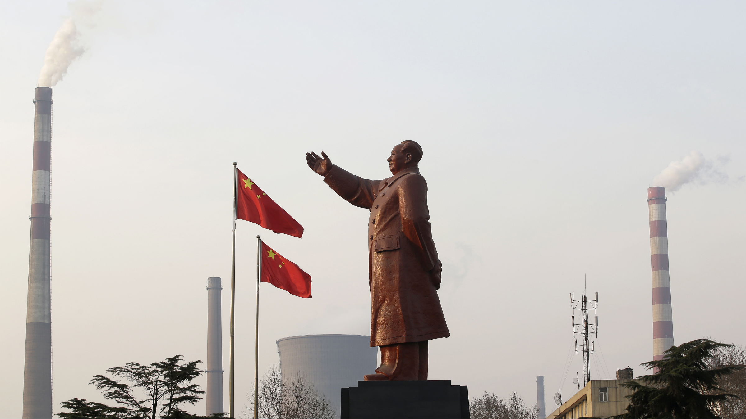 DATE IMPORTED:March 10, 2013A statue of former Chinese leader Mao Zedong is seen in front of smoking chimneys at Wuhan Iron And Steel Corp in Wuhan, Hubei province, March 6, 2013. China will impose new restrictions on its sprawling steel sector as it battles chronic air pollution, but hopes that the curbs could also help tackle sector overcapacity and strengthen the country's struggling state-owned mills are likely to be dashed. Picture taken March 6, 2013. REUTERS/Stringe