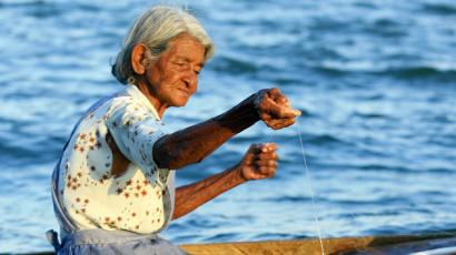 Regina Matarrita, 74, catches a fish in Puntarenas, Venado Island March 22, 2006. Fishing is the only source of income for the four hundred residents of this small 10-square-kilometer island as they struggle against large fishing operations. Costa Rica has approximately 9,000 fishermen, according to the Costa Rican Institute of Fish and Aquaculture.