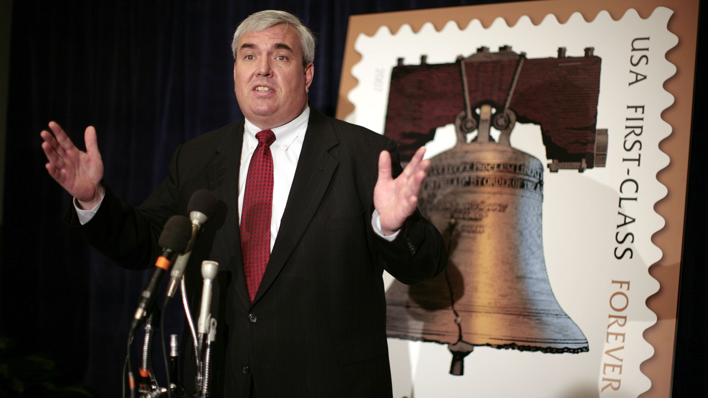 """U.S. Postmaster General John Potter answers a question during a news conference about the """"Forever Stamp"""" in Washington March 26, 2007. The stamp, which will be on sale to the public from April 12, will cost 41 cents and will be good for mailing one-ounce first-class  letters anytime in the future, regardless of price changes. REUTERS/Kevin Lamarque  (UNITED STATES) - RTR1NXX0"""