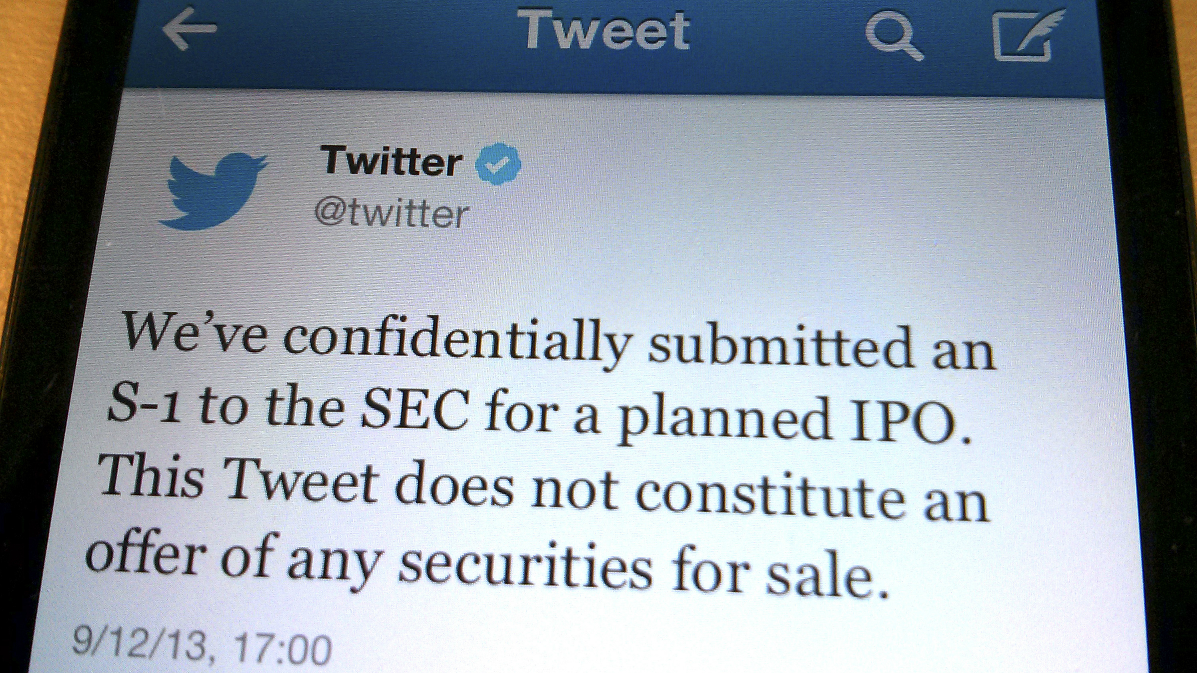 A tweet from Twitter Inc. announcing its initial public offering is shown in this photo illustration in Toronto, September 12, 2013. Twitter Inc has filed confidentially for an initial public offering, the company said on Thursday, taking the first step toward what would be Silicon Valley's most anticipated debut since Facebook Inc's last year. REUTERS/Hyungwon Kang