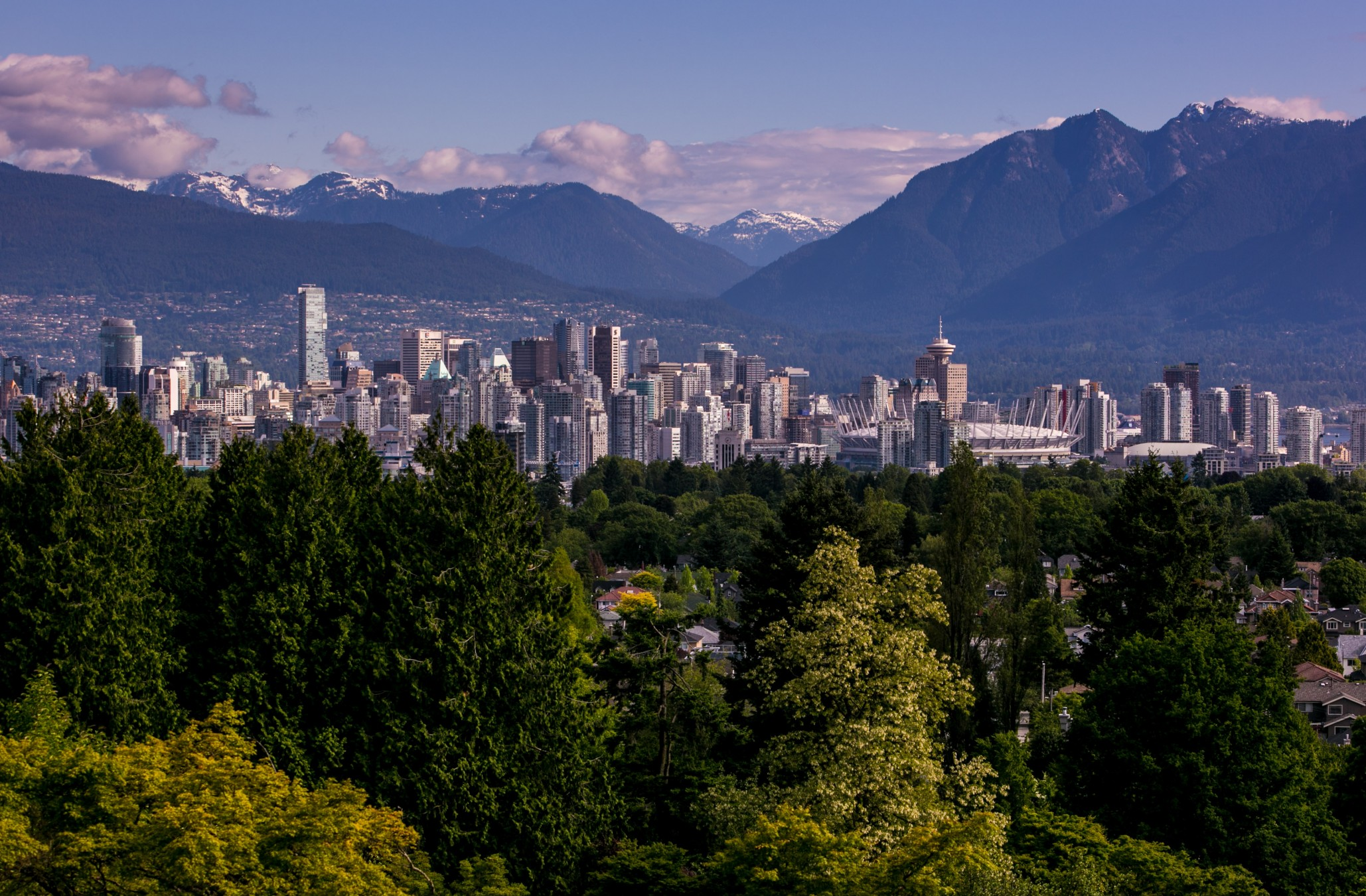 VANCOUVER, CANADA - JUNE 3: The downtown skyline is viewed from Queen Elizabeth Park on June 3, 2013 in Vancouver, British Columbia, Canada. Vancouver is a seaport city with close trading ties to Asia and is the most populous city in Western Canada, with nearly 2.3 million residents in the metropolitan area. (Photo by George Rose/Getty Images)