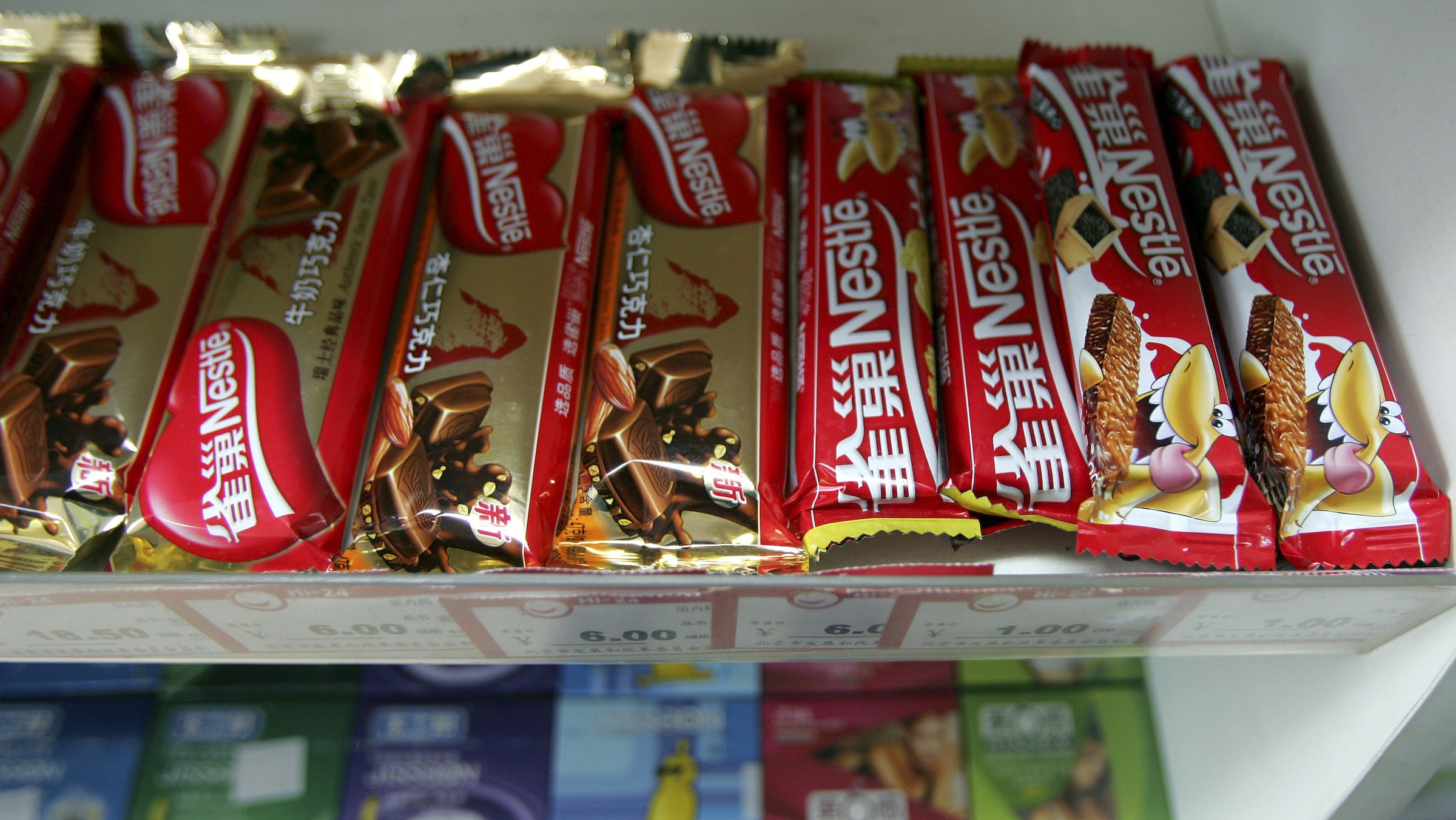 Nestle chocolate bars are seen in a store in Beijing Friday, April 20, 2007. America's leading candymaker, The Hershey Co., is seeking to join its top competitors on more candy shelves in places like India and China as it makes a bid to expand its global presence.(AP Photo/Greg Baker)