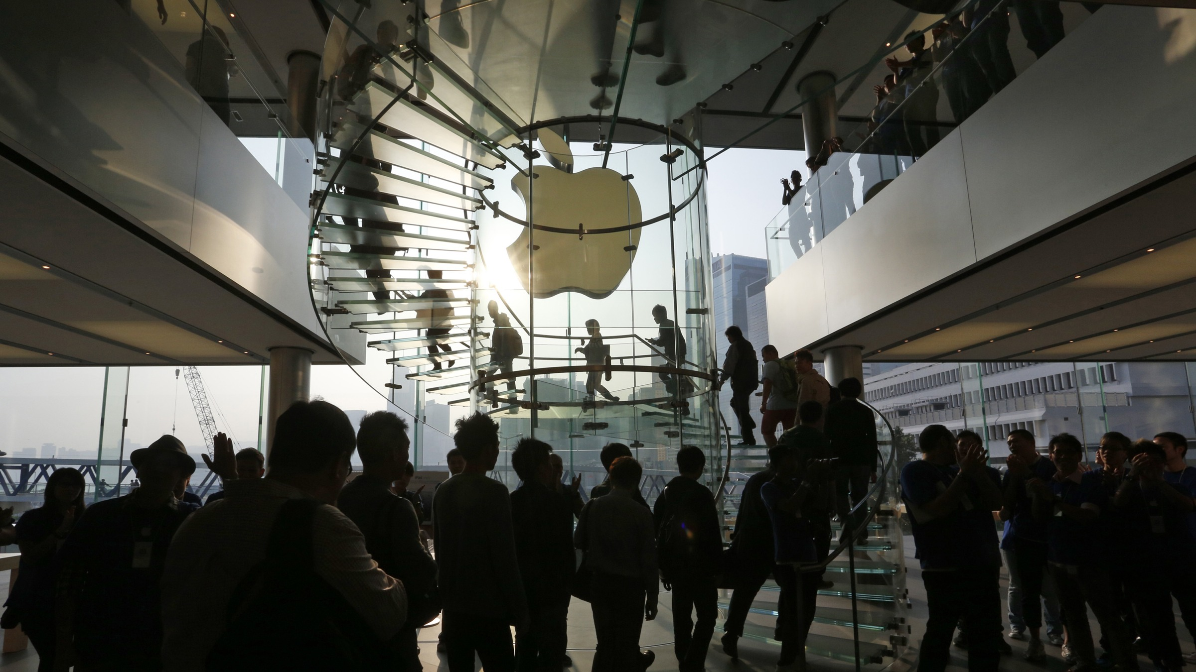 Customers get inside the Apple store in Hong Kong to buy Apple's iPad Mini Friday, Nov. 2, 2012. (AP Photo/Vincent Yu)