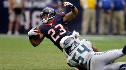Houston Texans running back Arian Foster (23) is tackled by Seattle Seahawks middle linebacker Bobby Wagner (54) during the fourth quarter an NFL football game Sunday, Sept. 29, 2013, in Houston.