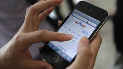 A user loads the Baidu homepage on her Apple iPhone 4 during the Baidu 2011 technology innovation conference in Beijing, September 2, 2011. China's top search engine Baidu Inc launched a new mobile application system on Friday, seeking to bolster its presence in the mobile web as competitors including Alibaba Group increase their mobile offerings. REUTERS/Jason Lee