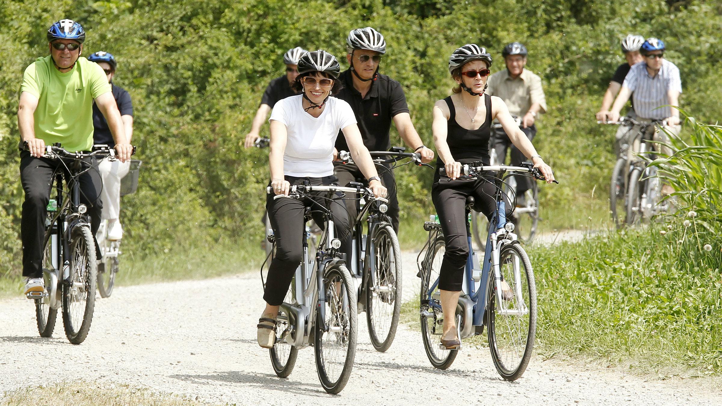 Swiss President Doris Leuthard and others ride e-bikes near Zurich.