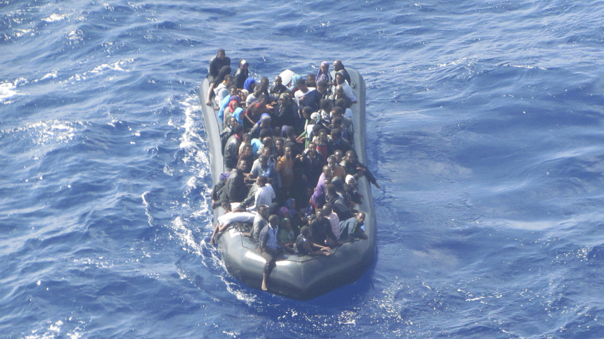 Some 93 immigrants are seen crammed onto a rubber dinghy filmed from a Guardia di Finanza police helicopter near the southern coast of the Sicilian island Lampedusa October 8, 2012. Picture taken October 8, 2012. REUTERS/Guardia di Finanza Press Office/Handout