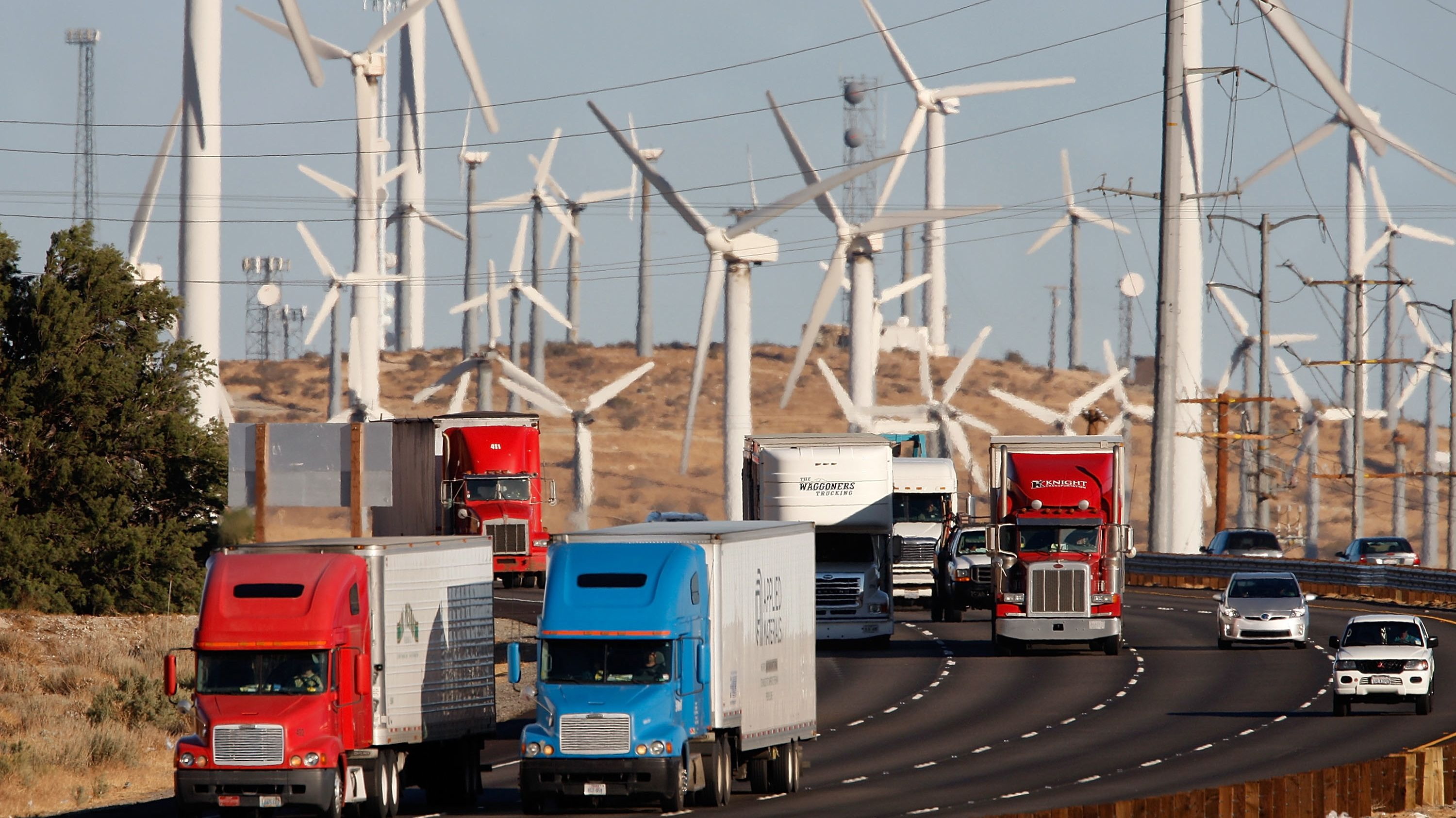BANNING, CA - DECEMBER 8:  Emissions-producing diesel trucks and cars pass non-polluting windmills along the 10 freeway on December 8, 2009 near Banning, California. Sustained global warming shows no sign of letting up according to new analysis by the World Meteorological Organization made public at the climate talks in Copenhagen. Although global temperature fluctuates from year to year, overall the decade of the 2000s is likely the warmest decade in the past 150 years covered by the report. This decade is warmer than the 1990s which were warmer than the 1980s, and so on. The conclusion meshes with independent analysis by the National Climatic Data Center and NASA.  (Photo by David McNew/Getty Images)