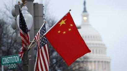 The People's Republic of China flag and the U.S. Stars and Stripes fly on a lamp post along Pennsylvania Avenue near the U.S. Capitol in Washington during Chinese President Hu Jintao's state visit, January 18, 2011. Hu arrived in the United States on Tuesday for a state visit with U.S. President Barack Obama that is aimed at strengthening ties between the world's two biggest economies. REUTERS/Hyungwon Kang