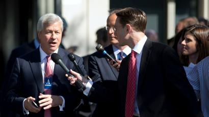 Jamie Dimon (L), chairman and CEO of JP Morgan Chase, is questioned by journalists as he and other CEOs arrive at the White House in Washington, October 2, 2013, for a meeting of the Financial Services Forum with U.S. President Barack Obama.