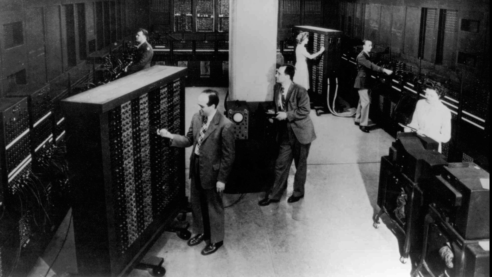 J. Presper Eckert, foreground left, and John W. Mauchly, leaning against pole, are pictured with the Electronic Numerical Integrator and Computer (ENIAC) in this undated photo from the University of Pennsylvania Archives. They were the masterminds behind ENIAC which was introduced on Feb. 14, 1946. Fully operational, ENIAC filled up a room 30 x 50 feet and weighed 50 tons. The development of smaller personal computers in 1981 by IBM, and the portable laptop version have tranformed our world from an industrial age to an informational age.