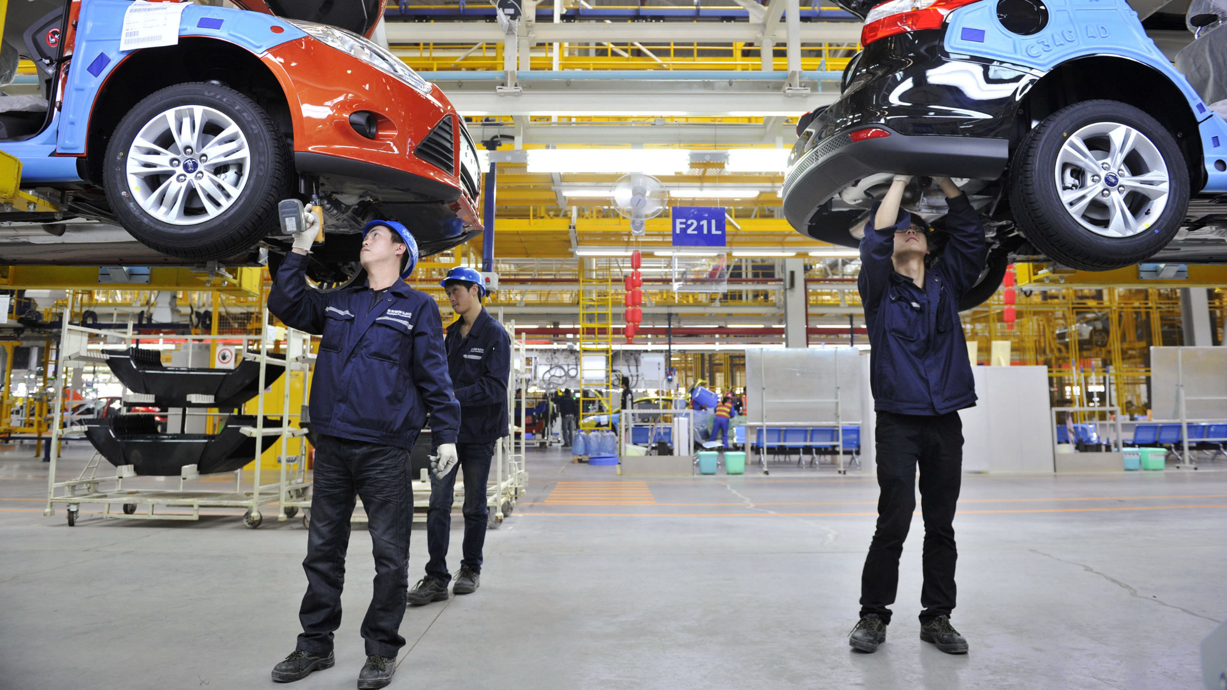 Employees install car components at an assembly line at a Ford manufacturing plant in Chongqing municipality, April 20, 2012. The new Ford car massive manufacturing plant, which opened in February, will need to be a success if Ford is to get a better foothold in the world's biggest car market, where it badly lags rivals such as General Motors Co and Volkswagen AG, which together produced the six top-selling cars in the country in 2011. Ford -- which was late getting into China -- had just 2.8 percent of the 18.5 million vehicle market last year, against GM's 14 percent and VW's 12 percent. Picture taken April 20, 2012. To match FEATURE FORD-CHINA/ REUTERS/Stringer