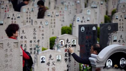 A man cleans the tombstone of a deceased relative during the Qingming Festival, or Tomb Sweeping Day at Songhe graveyard, on the outskirts of Shanghai April 4, 2013. The festival, which falls on April 4 this year, is a day for the Chinese to remember and honour their ancestors. A new service standard aimed at regulating the quality of China's public cemeteries has been launched by the Ministry of Civil Affairs to cope with the country's ageing population, according to Xinhua News Agency. REUTERS/Carlos Barria