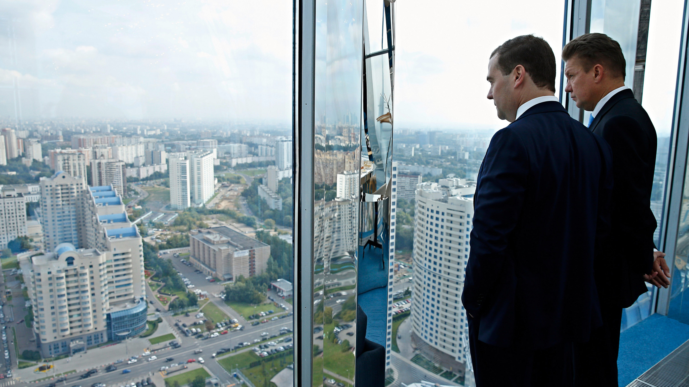 Russian Prime Minister Dmitry Medvedev, left, and Russian gas monopoly Gazprom Head Alexei Miller meet in the Gazprom headquarters in Moscow, Friday, Aug. 30, 2013.