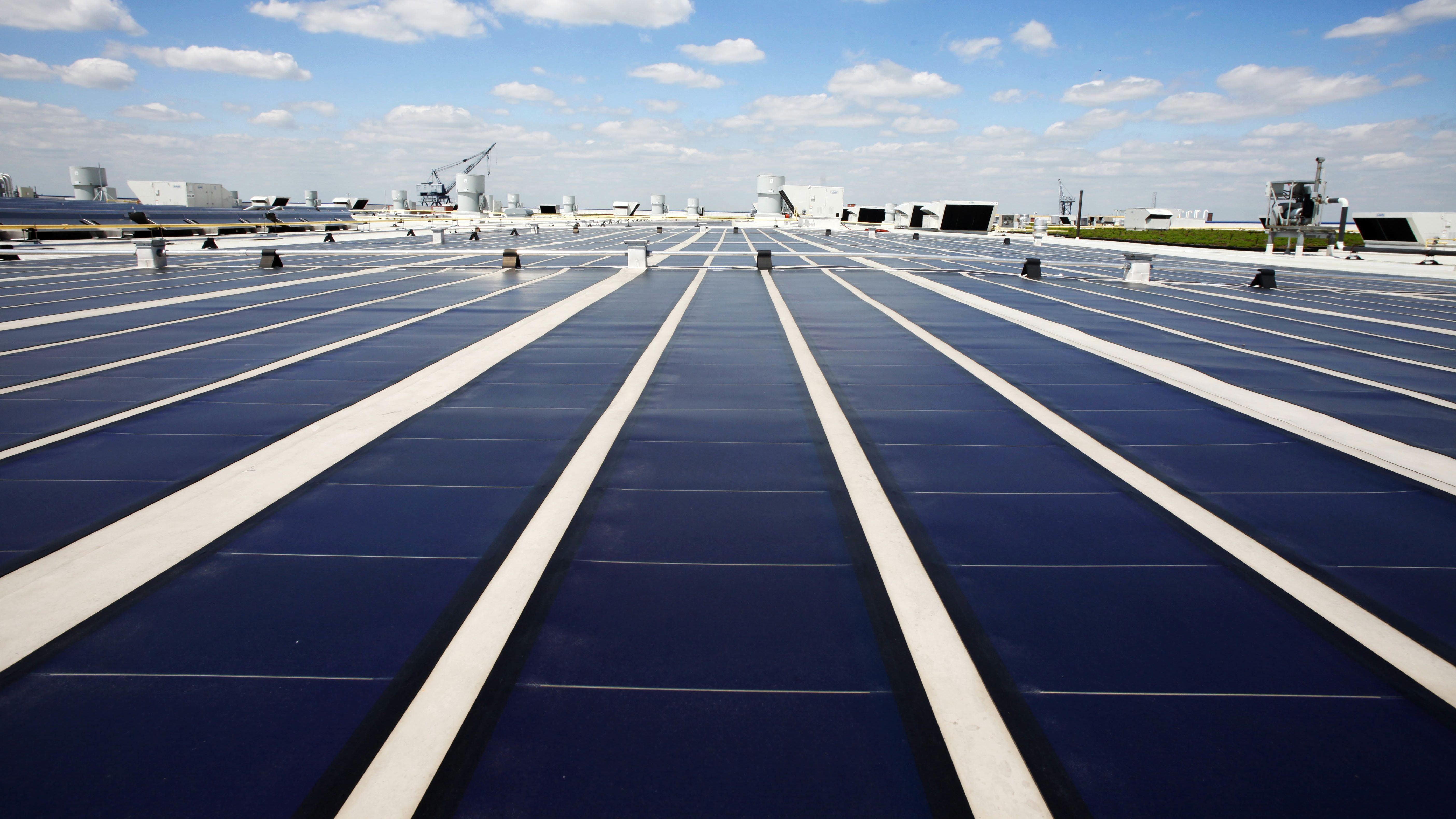 Solar panels line the roof of Ikea's Brooklyn store, Friday, April 29, 2011 in New York. The 19,000-square feet of panels will generate 240,000 kWh of electricity for the store. (AP Photo/Mark Lennihan)