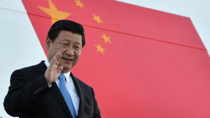 In this photograph provided by the G20 host broadcaster, China's President Xi Jinping waves as he arrives in St. Petersburg, Russia on Wednesday, Sept. 4, 2013. U.S. President Barack Obama will seek to bolster international support for a strike against Syria during talks with world leaders this week at the Group of 20 summit. Those efforts will pit him against Russian president and summit host Vladimir Putin, who has perhaps done the most to stymie international efforts to oust Syria's Bashar Assad. The G20 summit begins on Thursday, Sept. 5. (AP Photo/g20Russia
