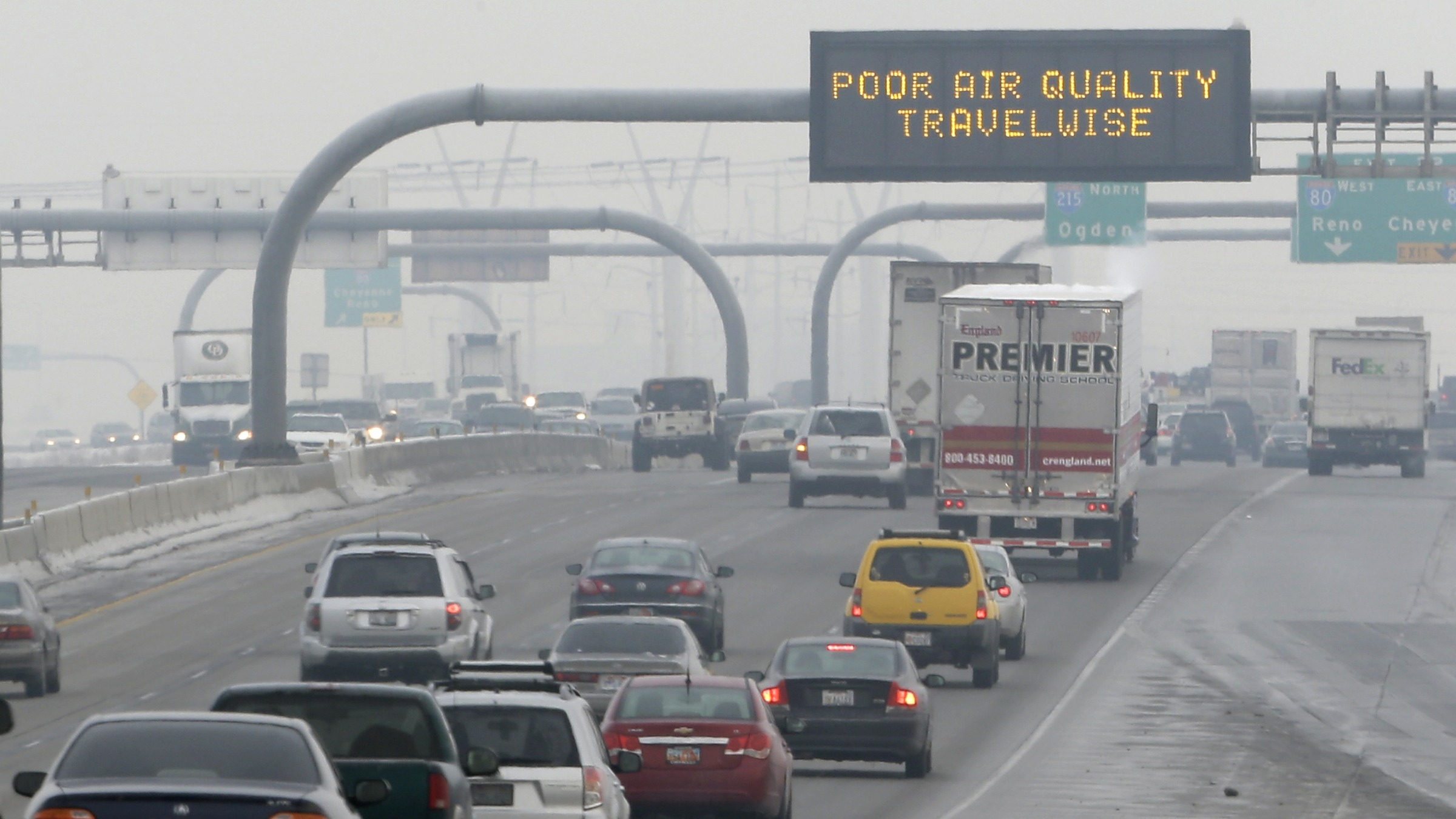 FILE - This Jan. 23, 2013, file photo, shows a poor air quality sign is posted over a highway, in Salt Lake City.  A watchdog group believes regulators could lean more heavily on industry to cut emissions in urban areas of northern Utah. The Healthy Environment Alliance of Utah is scrutinizing a plan to fight air pollution that regulators are shopping for public comment. The plan requires wider use of off-the-shelf technology to control industrial emissions, but stops at requiring the most advanced controls.  (AP Photo/Rick Bowmer, File)