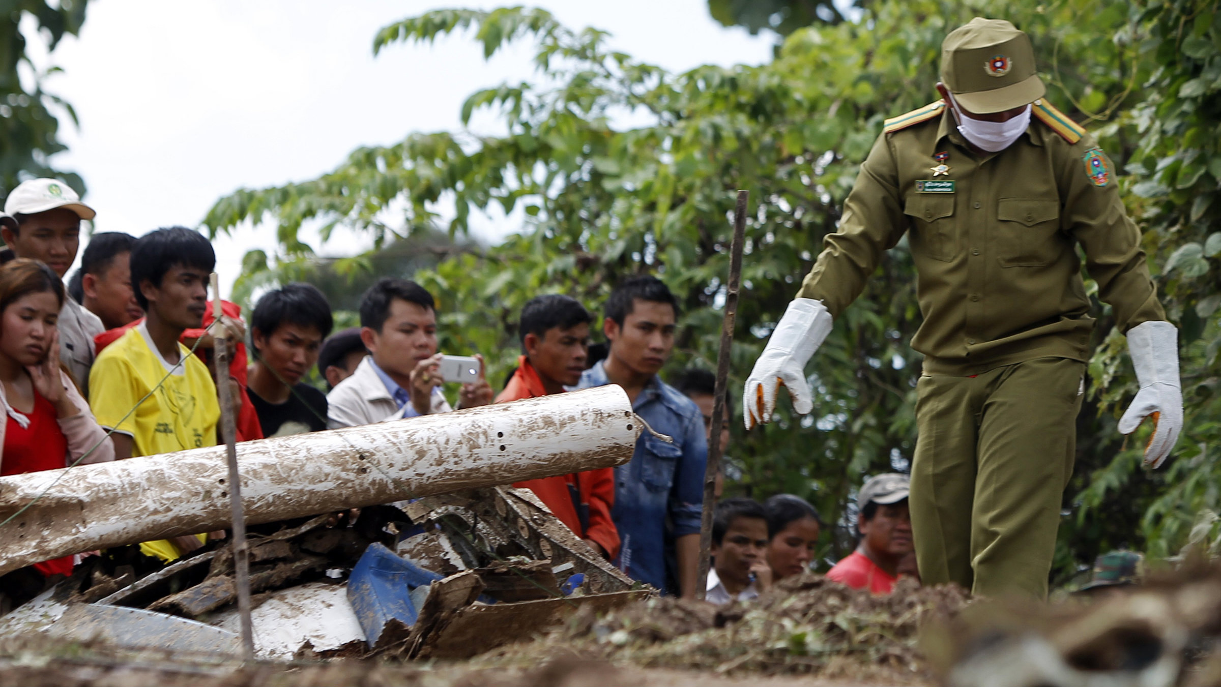 Villagers and rescue personnel near Pakse, Laos.