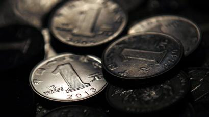 One Chinese yuan coins are seen in this photo illustration taken in Shanghai April 7, 2013. Chinese banks made 1.06 trillion yuan ($171.2 billion) of new local currency loans in March, central bank data showed on Thursday, well above market expectations and adding to evidence of an economic recovery being fuelled by ample credit. Picture taken April 7, 2013. REUTERS/Carlos Barria