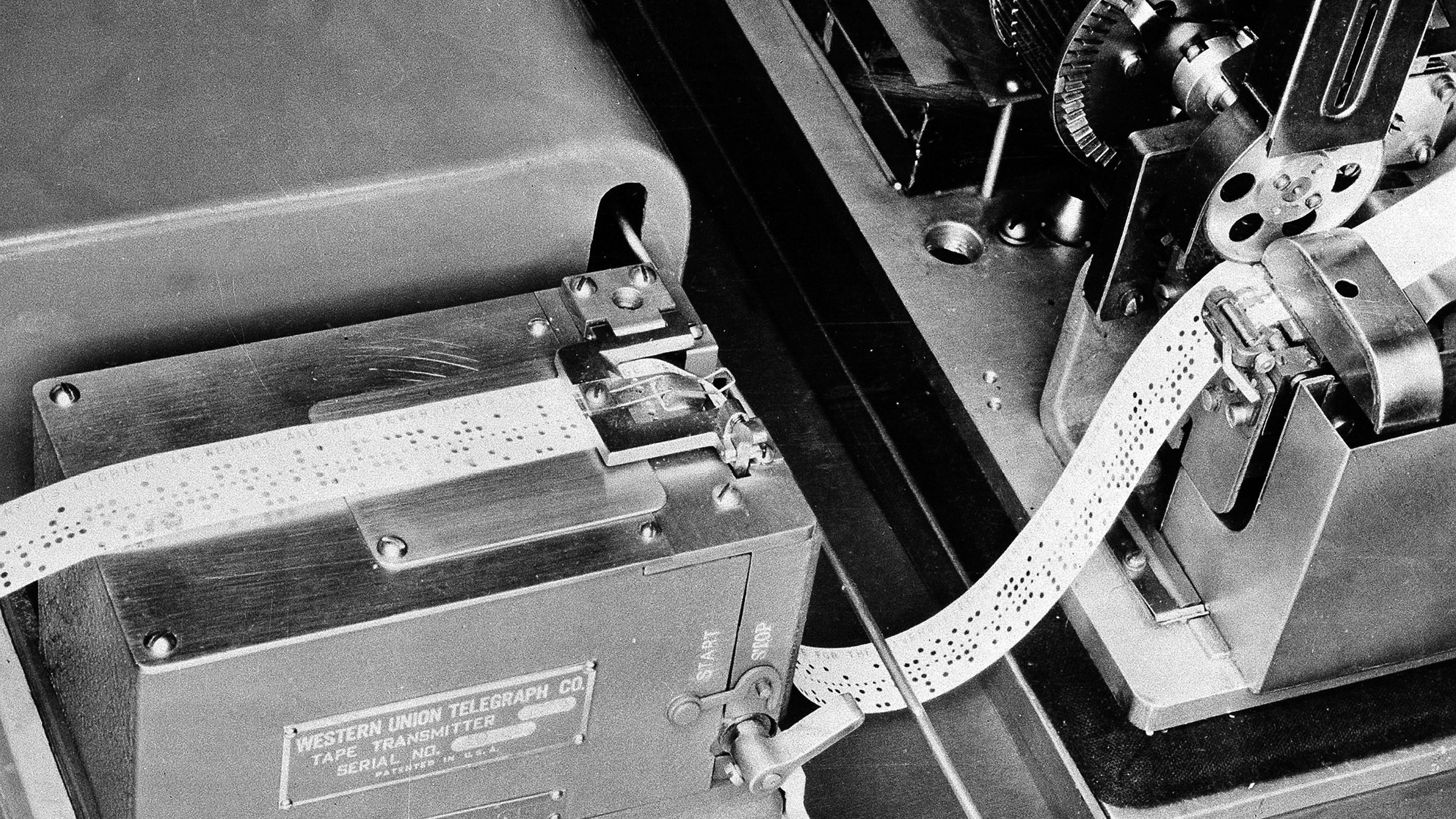 This is the current device used by Western Union which translates a telegram into holes on a tape, and then passes it along to the box-like apparatus at upper left, seen May 16, 1944.