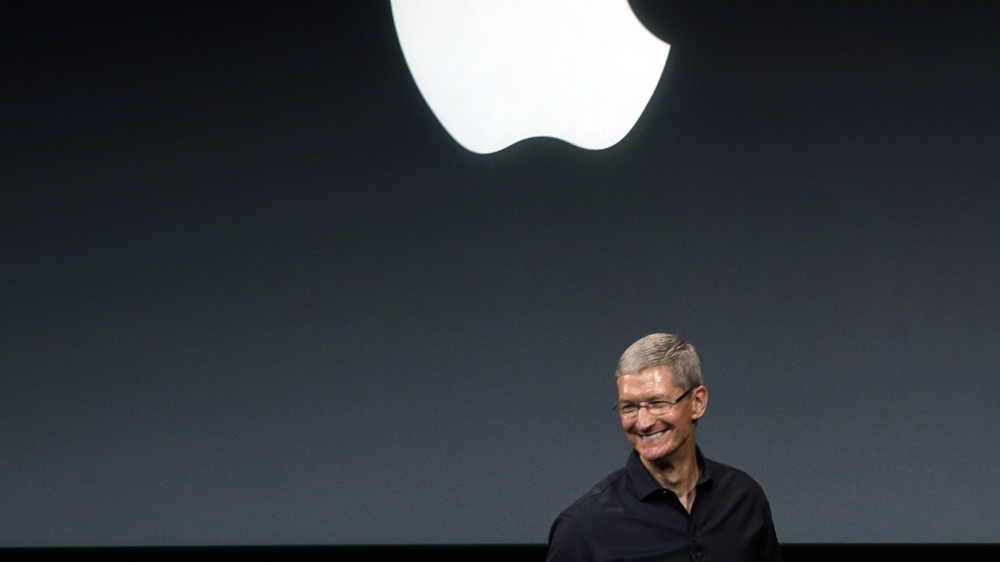 Apple CEO Tim Cook speaks on stage before a new product introduction in Cupertino, Calif., Tuesday, Sept. 10, 2013. (AP Photo/Marcio Jose Sanchez)
