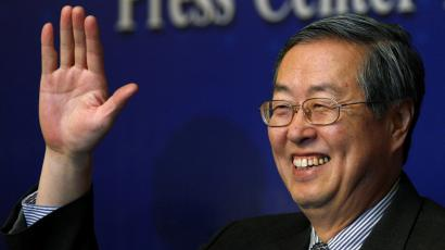 "China's central bank governor, Zhou Xiaochuan, waves as he arrives for his annual news conference in Beijing, outlining his views on the challenges ahead for the world's second-largest economy March 11, 2011. Zhou said current inflationary expectations are generally stable and reiterated his stance towards the exchange rate policy, adding that the bank refers to a basket of currencies in making adjustments and will keep the renminbi exchange rate ""basically stable at a reasonable and balanced level"". REUTERS/David Gray"