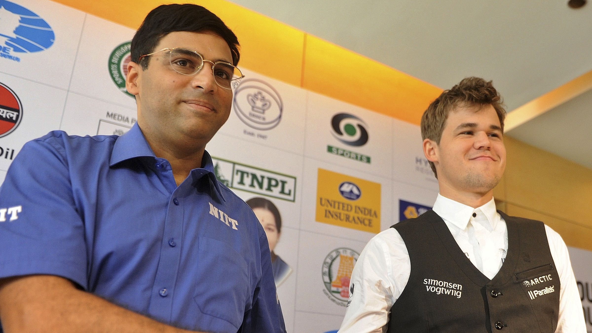 Reigning world chess champion India's Viswanathan Anand, left and world's top-ranked player Norway's Magnus Carlsen pose for the media at a press conference ahead of the FIDE World Chess Championship in Chennai, India, Thursday, Nov. 7, 2013. 43-year-old Anand and 22-year-old Carlsen will play their first match of the 12-match series from Saturday. (AP Photo/Arun Sankar K )