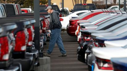 In this Sunday, Jan. 20, 2013 file photo, a buyer moves between rows of 2013 Ram pickup trucks and Dart sedans at a Dodge dealership in Littleton, Colo. Chrysler's U.S. sales rose 11 percent in May, a sign that auto sales rebounded from a slight dip in April and will continue to boost the U.S. economy. Ram pickup truck sales were strong, up 22 percent over a year ago to almost 32,000.