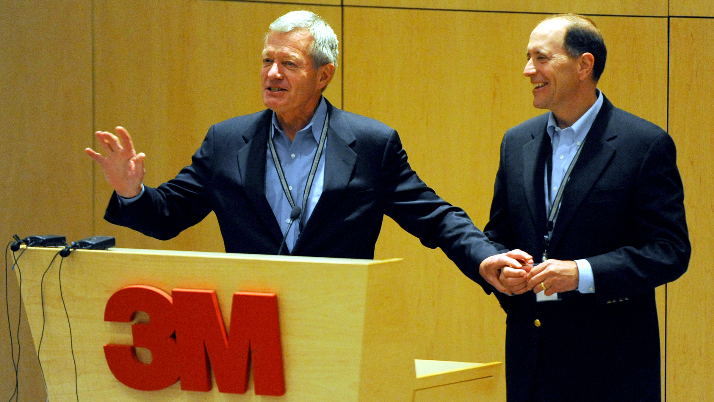 In this photo taken July 8, 2013, Senate Finance Committee Chairman Sen. Max Baucus, D-Mont., left, and the House Ways and Means Committee Chairman, Rep. Dave Camp, R-Mich., talk about tax reform to 3M employees at the 3M Innovation Center in Maplewood, Minn. Two of the most powerful members of Congress, Baucus, a Democrat, and Camp, a Republican, are touring the country to rally support for their effort to overhaul the nation's tax laws. They've developed a close friendship as they work to attract other lawmakers to their cause while helping Democrats and Republicans get to know each other a bit better. Their secret weapon: burgers and beer.