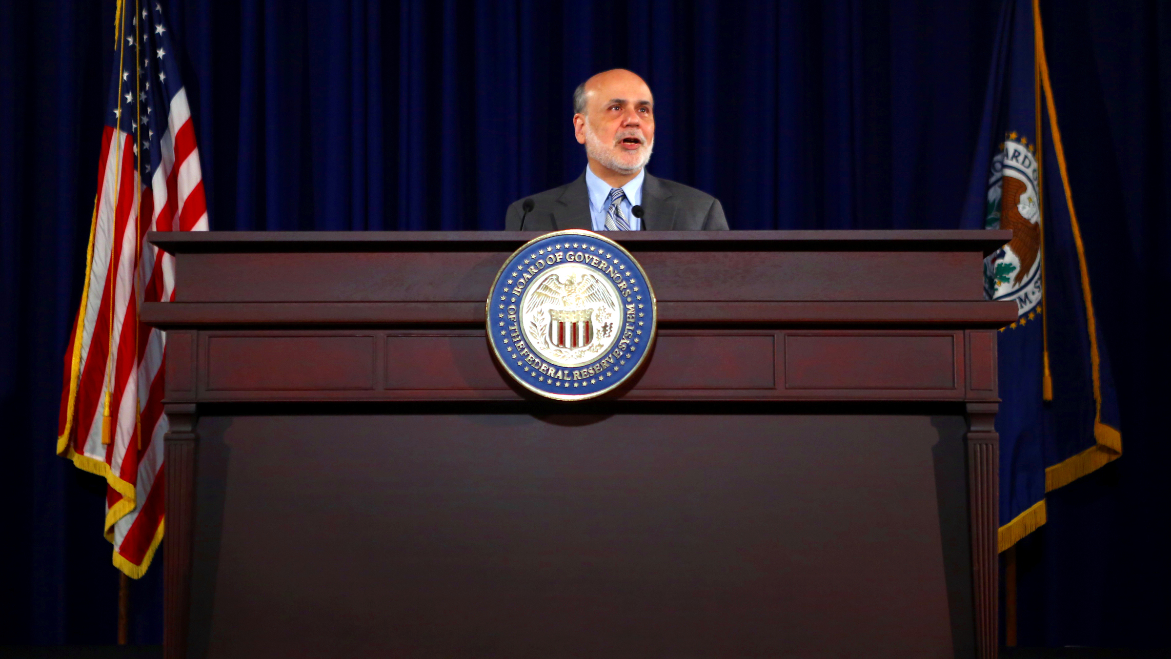 U.S. Federal Reserve Board Chairman Ben Bernanke holds a news conference following the Fed's two-day Federal Open Market Committee (FOMC) meeting in Washington September 18, 2013. The Fed said on Wednesday that it would continue buying bonds at an $85 billion monthly pace for now, expressing concerns that a sharp rise in borrowing costs in recent months could weigh on the economy.