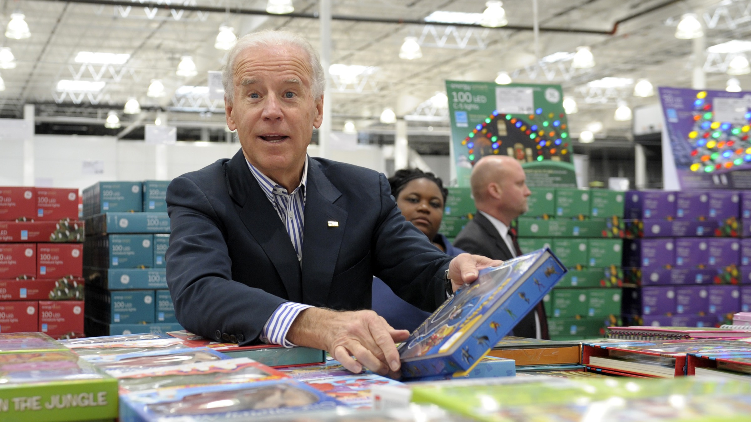 Vice President Joe Biden looks over a selection of books while shopping at a Costco in Washington, Thursday, Nov. 29, 2012. Biden went shopping for presents and to highlight the importance of renewing middle-class tax cuts so families and businesses have more certainty at this critical time for our economy. (AP Photo/Susan Walsh)