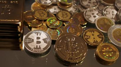 Bitcoins created by enthusiast Mike Caldwell are seen in a photo illustration at his office in Sandy, Utah, September 17, 2013. Caldwell produces physical coins Bitcoins, which have been around since 2008, are a form of electronic money that can be exchanged without using traditional banking or money transfer systems. REUTERS/Jim Urquhart