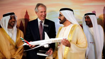 Boeing Chairman James McNerney (2nd L) shows United Arab Emirates' Prime Minister and Ruler of Dubai Sheikh Mohammed bin Rashid al-Maktoum (2nd R) a model of the new version of its 777 long-haul jet during the Dubai Airshow November 17, 2013. Boeing launched the long-awaited new version of its 777 long-haul jet with 259 orders from four airlines at the Dubai Airshow on Sunday. McNerney said the order, based on commitments worth some $100 billion at list prices, was the largest combined order in the company's history. The deal includes orders for 150 of the aircraft from Dubai's Emirates, 50 from Qatar Airways and 25 announced earlier by Abu Dhabi's Etihad Airways.