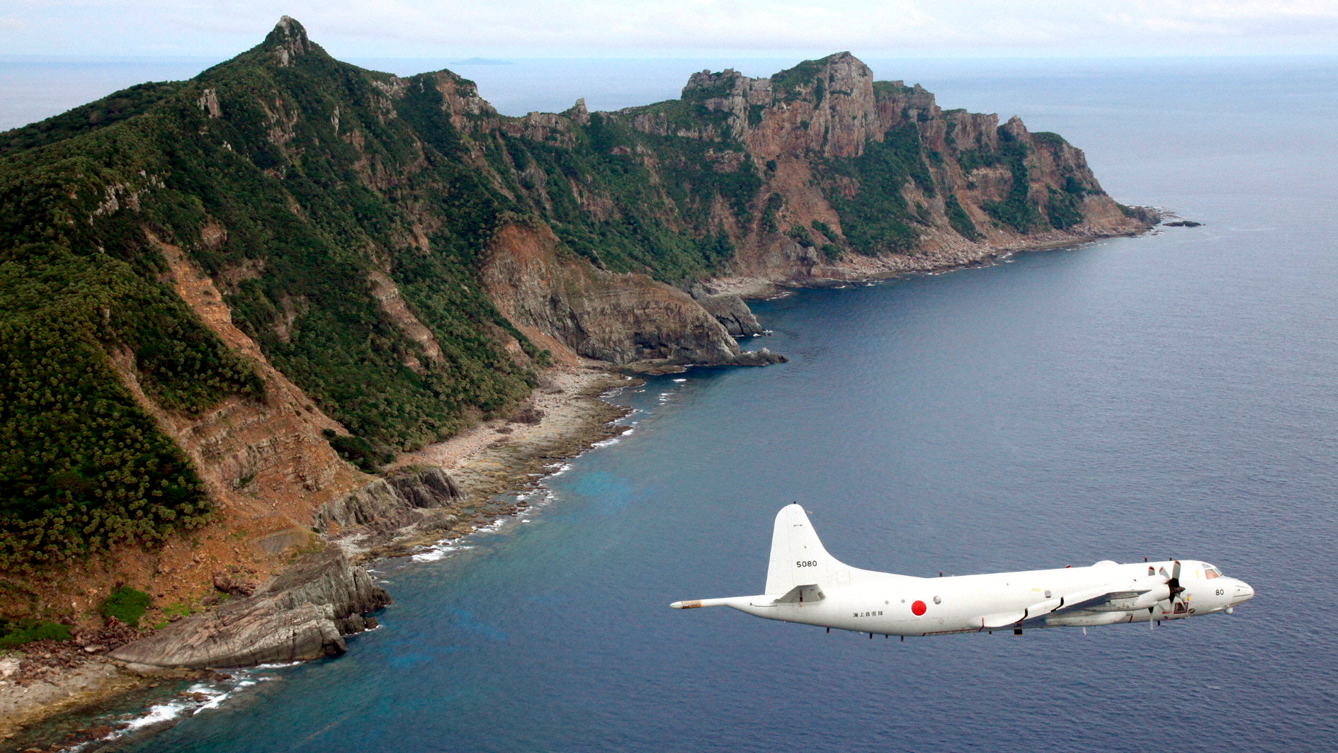 "Japan Maritime Self-Defense Force's PC3 surveillance plane flies around the disputed islands in the East China Sea, known as the Senkaku isles in Japan and Diaoyu in China, October 13, 2011. China's Foreign Ministry said it would continue to take ""necessary measures"" to safeguard its sovereignty over a number of disputed islands in the East China Sea after Japan said it was considering a plan to ""buy"" them from private landowners. Picture taken October 13, 2011."