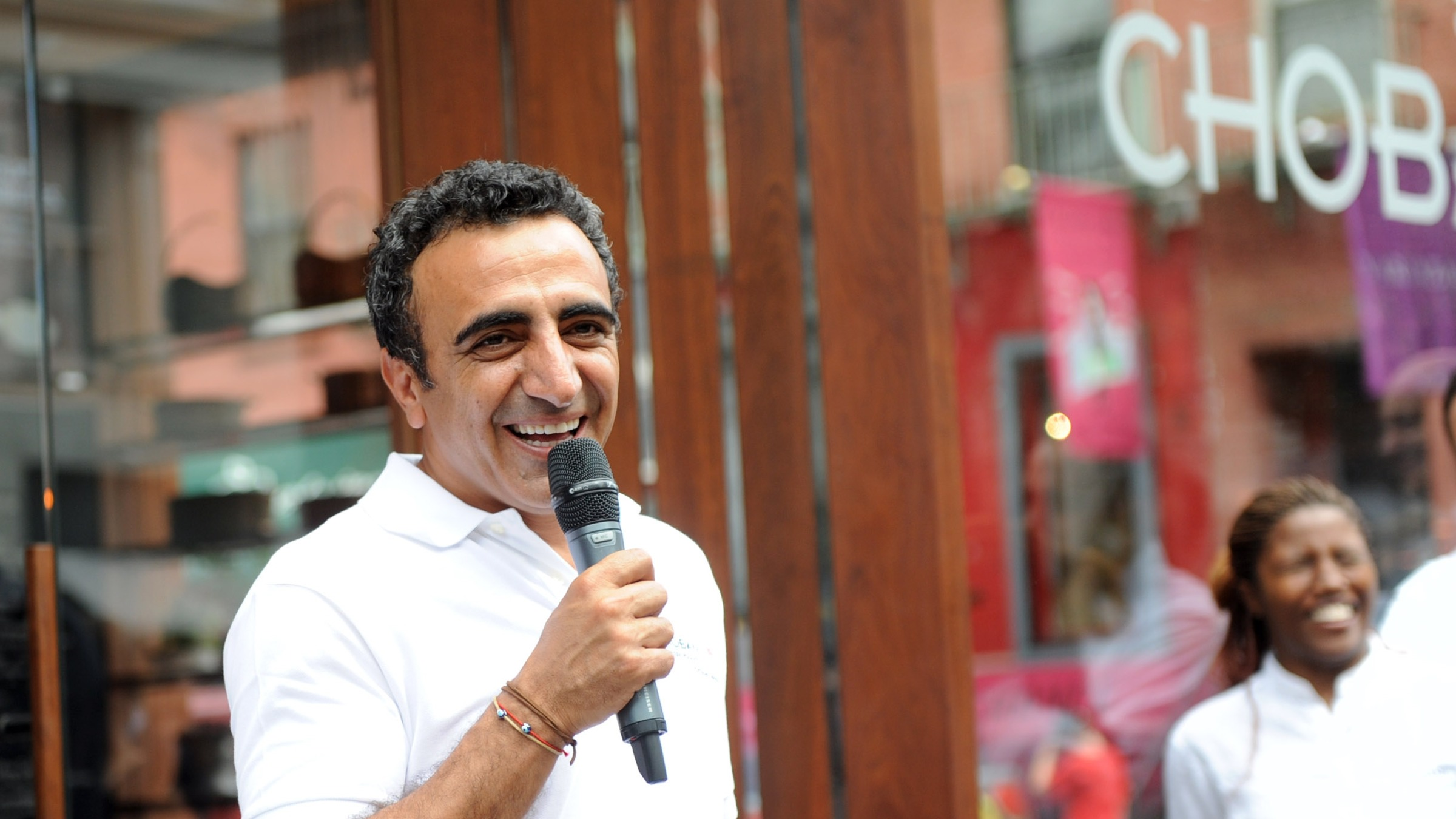 Hamdi Ulukaya, President and CEO of Chobani, speaks at the opening celebration of  Chobani SoHo, a first-of-its-kind Mediterranean yogurt bar,  Wednesday, August 1, 2012, in New York.  (Photo by Diane Bondareff/Invision for Chobani)
